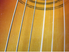 Guitar strings showing varying width and materials