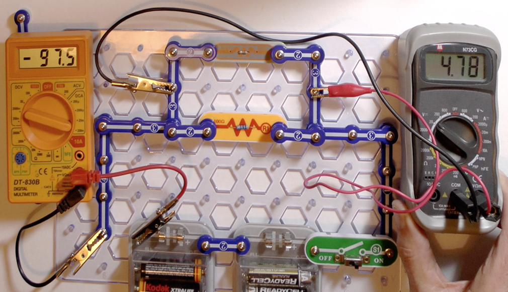 Showing how to measure the total resistance of two resistors in parallel